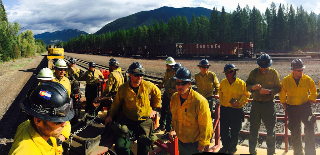 Thompson-Divide Complex Firefighters work on the tracks near Essex MT, Sep 1, 2015