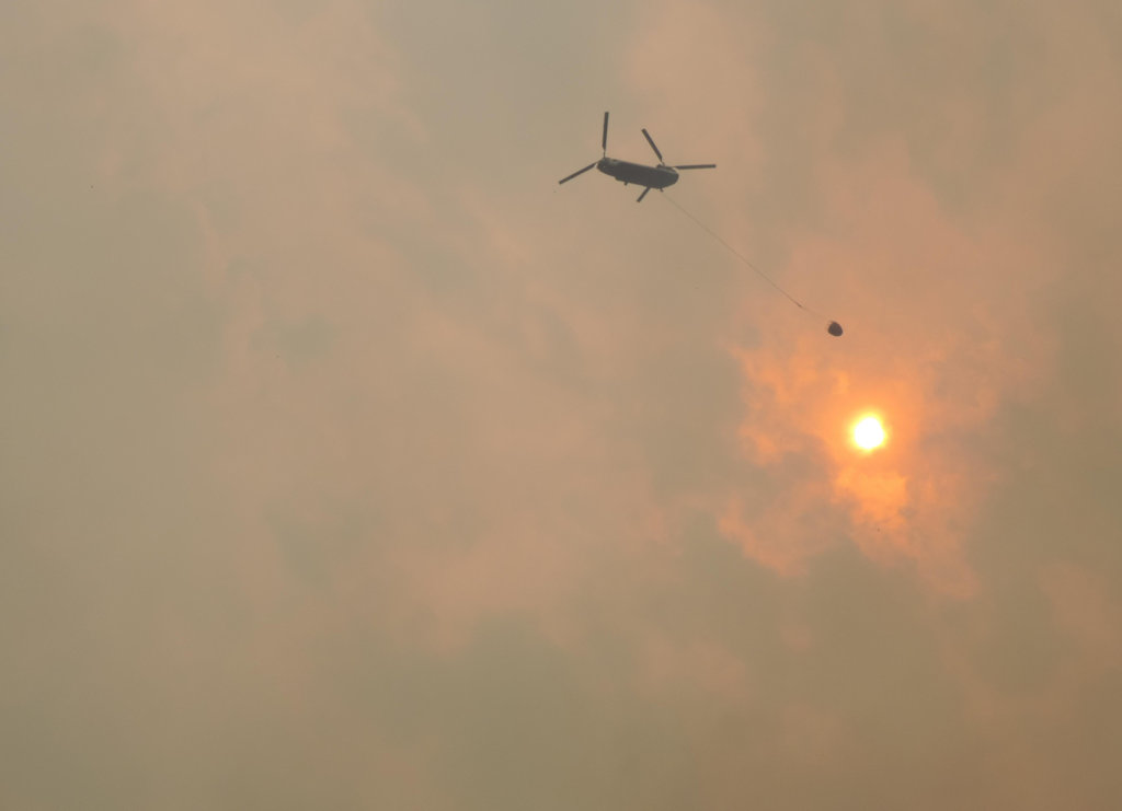 Helicopter conducts water drop operations on the Sheep Fire, 29 Aug, 2015