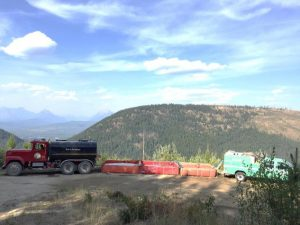 Cyclone Like Fire, Aug 2017 - Martin City water tender filling port-a-tanks, with Forest Service engine pumping water into hoses along the fire perimeter