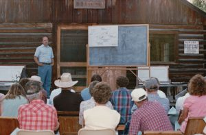 Bob Dunkley explains Park plans for the Polebridge Ranger Station, post Red Bench Fire, at the 1989 Interlocal at Sondreson Hall.